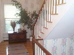 A staircase in a house; Size=240 pixels wide